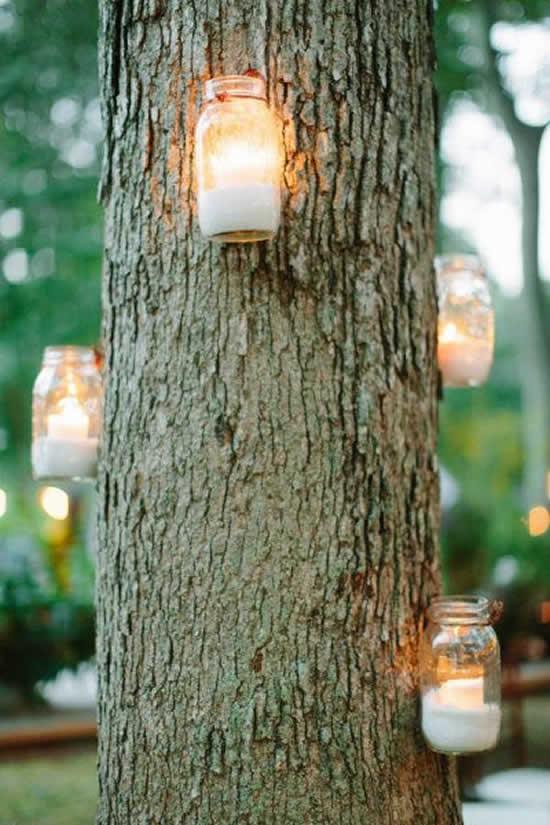 Potes de vidro e velas: decoração para casamento