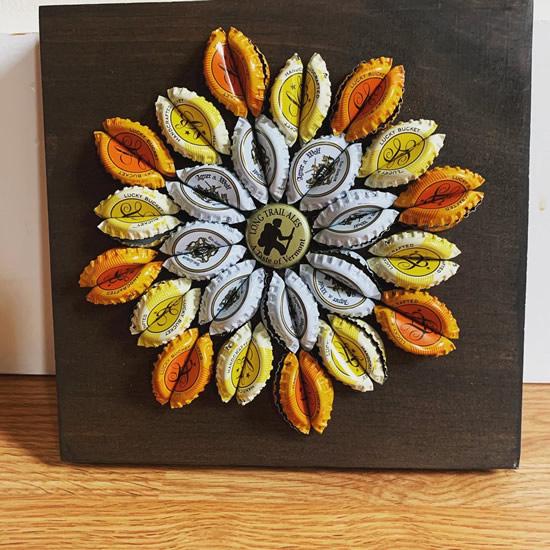 Flor com reciclagem de tampas